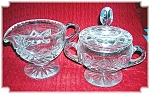 Click here to enlarge image and see more about item 0417200640: Cut Glass Sugar with Lid and Cream Pitcher