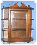 Click here to enlarge image and see more about item 0418200668: Glass Fronted Wooden Display Cabinet