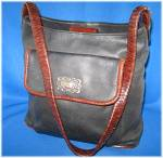 Click here to enlarge image and see more about item 0505200901: Fossil black and brown leather handbag