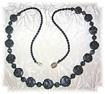 Click to view larger image of Carved Obsidian Faces 26 Inch Necklace (Image1)