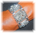 Click here to enlarge image and see more about item 0511200684: Silver Sarah Coventry Vintage Bracelet