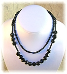 Click here to enlarge image and see more about item 0513200477: 31 Inch Hand Carved Jet Black Bead Necklace