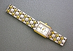 Click here to enlarge image and see more about item 0522200712: Silver and Gold NIVADA Ladies Quartz Wristwatch