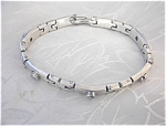 Click here to enlarge image and see more about item 0526200528: Sterling Silver & Bezel Set CZ Bracelet