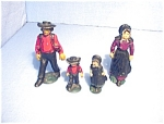 Click here to enlarge image and see more about item 0526200547: Amish Family Cast Iron Vintage
