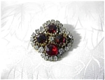 Click here to enlarge image and see more about item 05270324: Antique Ruby Red and Sparkling Paste  Crystal brooch