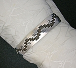 Click here to enlarge image and see more about item 0604200708: Sterling Silver American Indian Signed K Cuff Bracelet