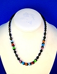 Click here to enlarge image and see more about item 06090261: 17 Inch Black/RedGreen/Amber/Blue Glass Beads