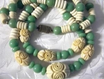 Necklace, carved Plastic Lucite, 2 strand
