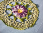 Click here to enlarge image and see more about item 06170212: Mauve and Yellow Flower Hand Crocheted Doiley