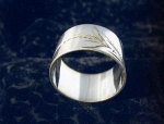Click here to enlarge image and see more about item 06170217: Silvertone Napkin Ring with Leaf Design.