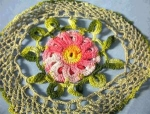 Click here to enlarge image and see more about item 06170219: Hand Crocheted Red Flower Doiley.