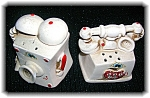 Click here to enlarge image and see more about item 06182006104: Ceramic Telephone Salt and Peppers.