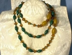 Click here to enlarge image and see more about item 06210244: Old Amber Glass and lucite/Bakelite Beads.