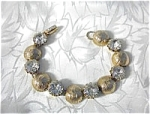 Click here to enlarge image and see more about item 06220317: Vintage KRAMER Crystal & Gold Bracelet