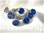 Click here to enlarge image and see more about item 0622200331: Silvertone & Cobalt Blue Glass Charm Bracelet