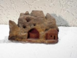 Click here to enlarge image and see more about item 06230208: Wooden Cliff House Carving.