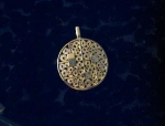 Sarah Coventry Goldtone Round Heavy Filigree Pendant  .