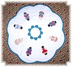 Click here to enlarge image and see more about item 06252006210: Quilted Children Of The World Centerpiece