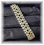 Click here to enlarge image and see more about item 0703200415: Goldtone and Sparkling Rhinestone Bracelet