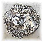 Click to view larger image of Brooch Pin Silver Kissing Boy and Girl Cherubs (Image1)