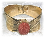 Click here to enlarge image and see more about item 0703200517: Vintage Gold & Goldstone Pull Apart Bracelet . . .