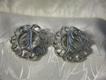 Click here to enlarge image and see more about item 0713200236: Silvertone SARAH COVENTRY Clip Earrings