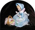 Click here to enlarge image and see more about item 0731200527: FIGURINE GIRL IN BLUE BONNET WITH BASKET