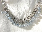 Click here to enlarge image and see more about item 08100307: Blue Glass GERMAN Charm Bracelet . . .