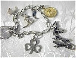 Click here to enlarge image and see more about item 08100331: Vintage Sterling Silver 7 Charm Bracelet