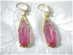 Click here to enlarge image and see more about item 08100341: Dangling Bubble Gum Pink German Earrings