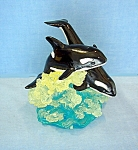 Click here to enlarge image and see more about item 0819200723: Dolphins In the Sea Ornament . . . .