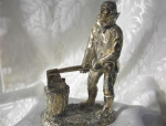 Click here to enlarge image and see more about item 0821200246: English Silver Plate Woodsman Figurine