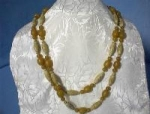 Click here to enlarge image and see more about item 08300231: Butterscotch Amber and Carved Bead Necklace