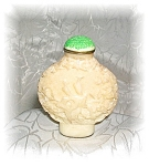Click here to enlarge image and see more about item 090920051e: White CINNABAR STYLE SNUFF BOTTLE