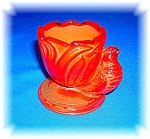 Click here to enlarge image and see more about item 0909200620: RARE RED GLASS EGG CUP WITH BIRD AND PAPER LABEL
