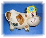 Click here to enlarge image and see more about item 0913200546: BANK - Vintage &  Smiling Daisy The Cow Money Bank . .