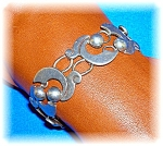 Click to view larger image of Signed Sterling Silver Taxco PATINO Bracelet (Image1)