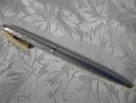 Click here to enlarge image and see more about item 0915200275: Gold and Silver Sheaffer Pen