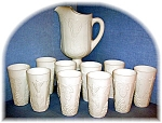 this is a beautiful set of Milk Glass harvest grape pattern Pitcher and 10 matching glasses.  The pitcher measures 11 inches at the spout and is 6 inches across.  Spout to handel measures 9 inches.  E...