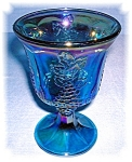 Click here to enlarge image and see more about item 0915200510: Blue Carnival Glass Grape Pattern  Wine Glass
