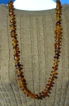 Click here to enlarge image and see more about item 0917200229: 30 Inch Nugget Necklace of Golden Amber Beads