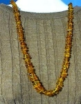 Click here to enlarge image and see more about item 0917200230: 29 Inch Honey Amber Nugget Bead Necklace