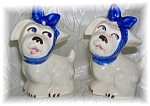 Click here to enlarge image and see more about item 0930200508: 2  Identical Doggie SHAWNEE Shakers