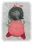 Click here to enlarge image and see more about item 1013200501: Americana Pin Cushion Black Lady with Tomato