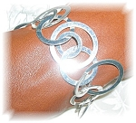 Click here to enlarge image and see more about item 1021200506: SILVERTONE FASHION BRACELET - UNIQUE.....