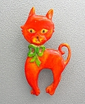 Click to view larger image of Bakelite Orange 50s Cat brooch Green Bow (Image1)