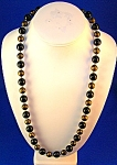 Click to view larger image of Vintage Black & Gold Plastic Lucite Necklace (Image1)