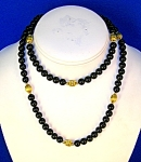 28 Inch Necklace of 7mm Black Onyx/Gold Beads