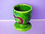 Pottery Egg Cup in green glaze . . .
